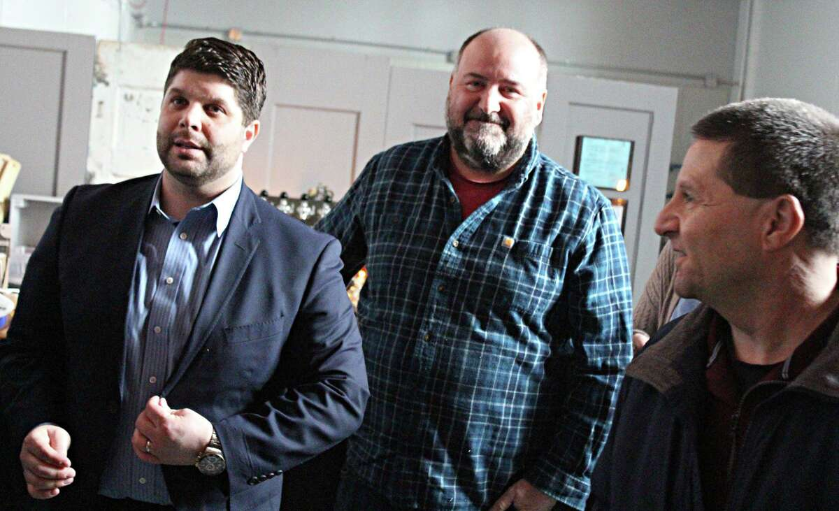 From left are Middletown Mayor Dan Drew, Ron Sansone, cofounder of the Connecticut Cider Association and owner of Spoke + Spy Ciderworks on Johnson Street, and Middlesex County Chamber of Commerce past chairman Rick Moran.
