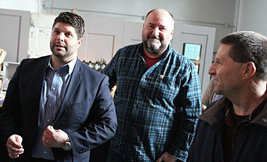 From left are Middletown Mayor Dan Drew, Ron Sansone, cofounder of the Connecticut Cider Association and owner of Spoke + Spy Ciderworks on Johnson Street, and Middlesex County Chamber of Commerce past chairman Rick Moran. Photo: Contributed Photo