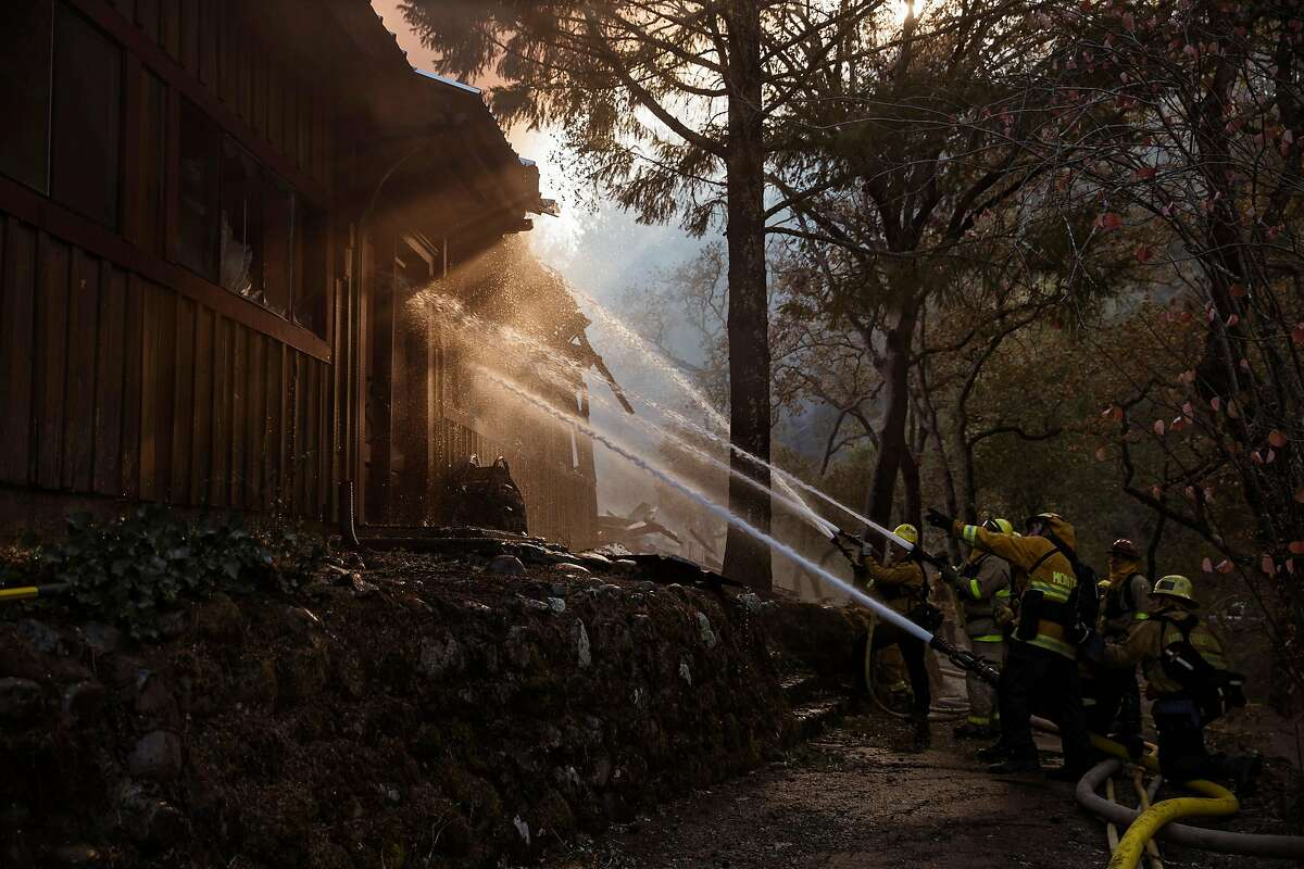 Firefighters work to save a burning structure as the Kincade fire continues to burn along highway 128 in Kellog, Calif. on Tuesday, Oct. 29, 2019.