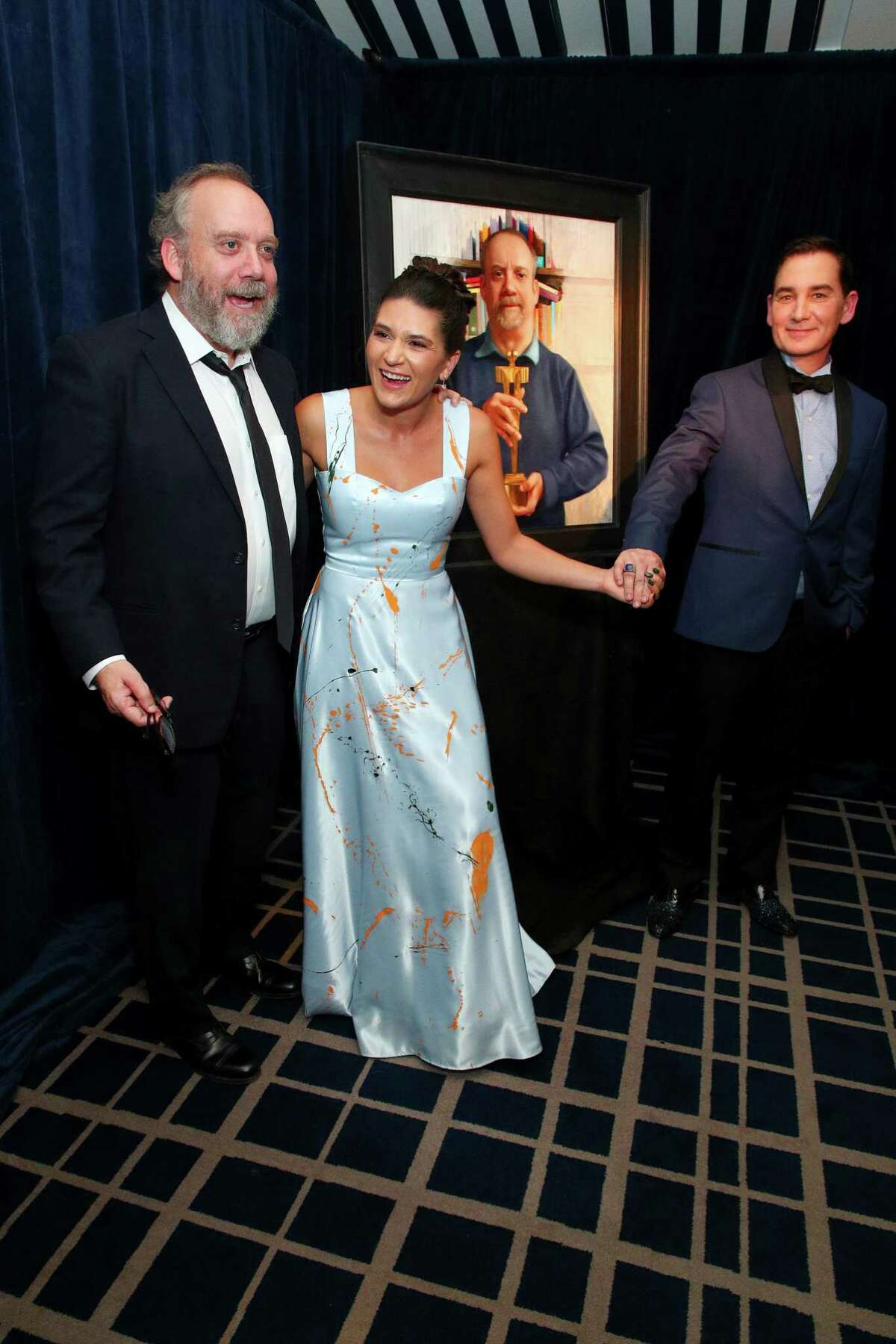 Paul Giamatti, Sequoia Schmidt and artist Graydon Parrish pose with his painting during the unveiling of Paul Giamatti fundraiser for the Denali Foundation at the Yale Club on October 24, 2019 in New York City.