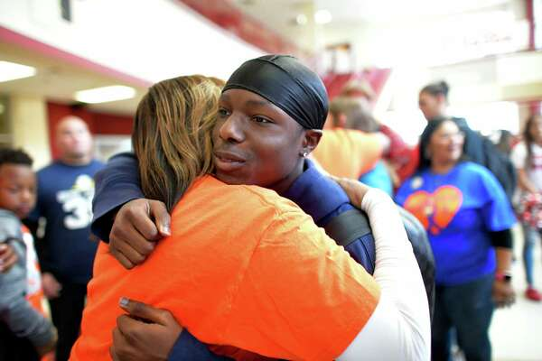 Bryce Wisdom, a student athlete at Judson High School who is fighting cancer, is embraced during a rally to encourage him on Friday, Oct. 11, 2019. He is leaving school to undergo 25 weeks of chemotherapy.