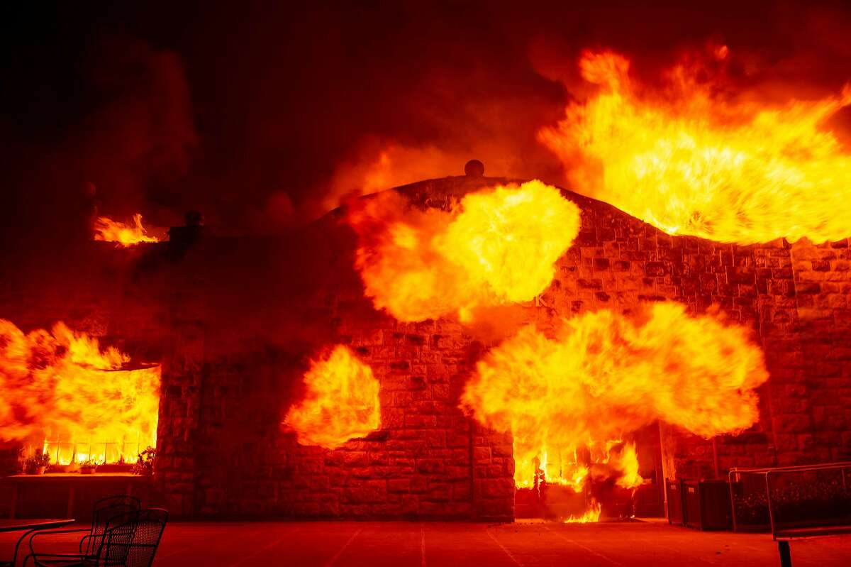 Fire explodes out the entrance of the Soda Rock Winery as it burns during the Kincade fire as flames race through Healdsburg, California on October 27, 2019.