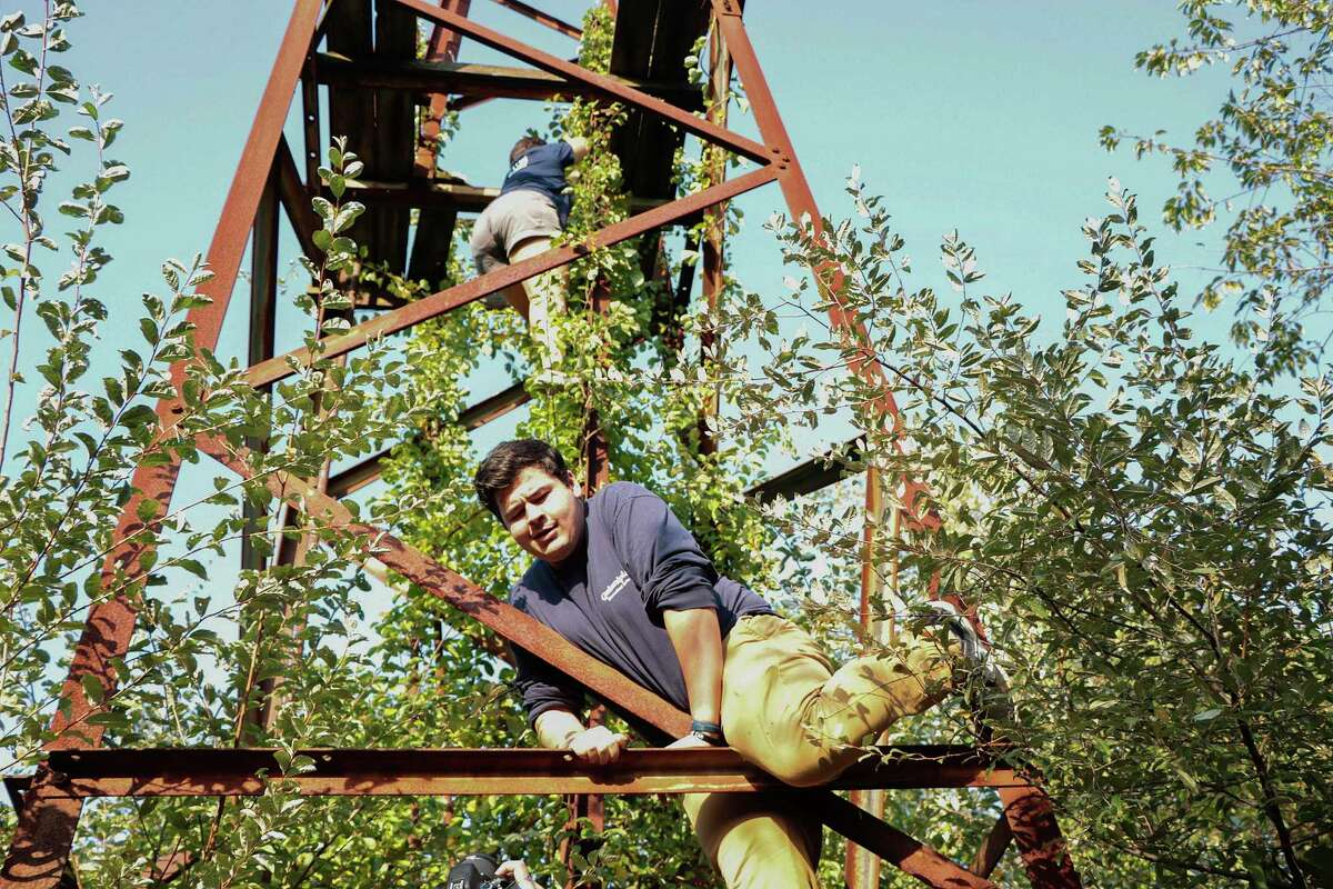 Urban explorer Josh Sprague climbs a tower at the old abandoned Cedar Hill rail yard in New Haven.