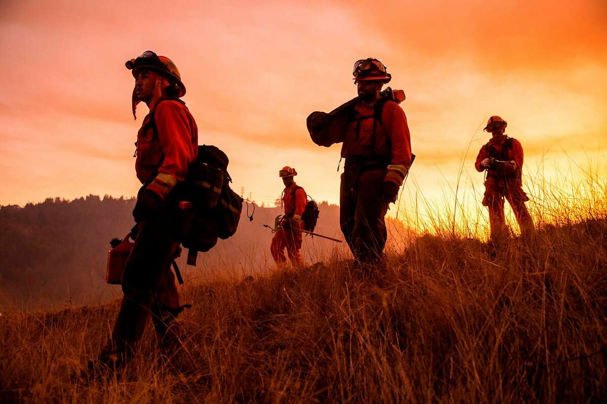 A crew of inmate firefighters make their way to firefighting operations to battle the Kincade Fire in Healdsburg, Calif., on Oct. 26, 2019.