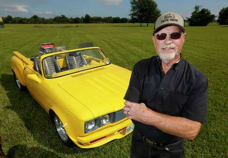 Ron Fehring poses in front of his Love Truck, a converted 1972 Chevy LUV on Oct. 28, 2019, in Baytown.