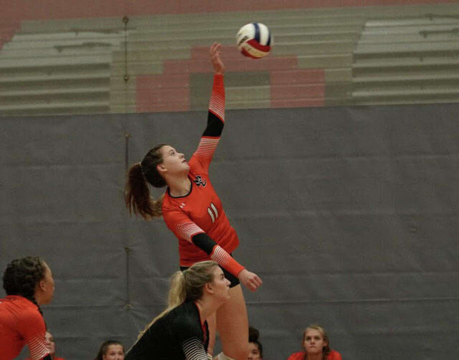 Edwardsville goes up for an attack during Tuesday's match against Alton in the Class 4A Alton Regional semifinals. Photo: Rick Brewer|For The Intelligencer