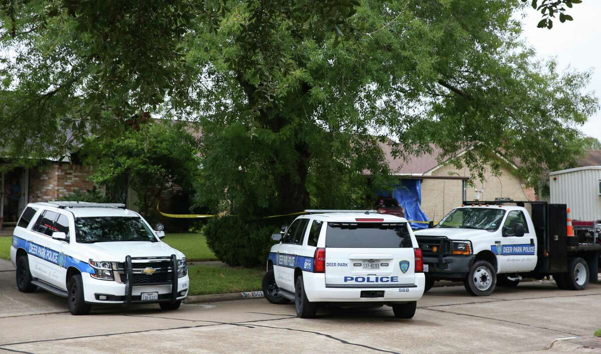Deer Park Police Department officers respond to the 1400 block of New Orleans Street where three children and one adult found dead inside a house on Tuesday, Oct. 29, in Deer Park.