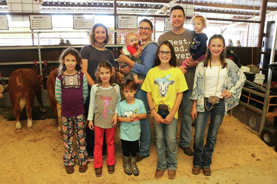 The Philley family—Lee, Jennifer, Ann Alyse, Avery, Alayna, Atley, Anaiya, Alden, Adelyn, and Abram are loving the country life in Dayton and raising their miniature Herefords. The family was together at the Trinity Valley Exposition Youth Auction where his children all excelled. Photo: David Taylor / Staff Photo
