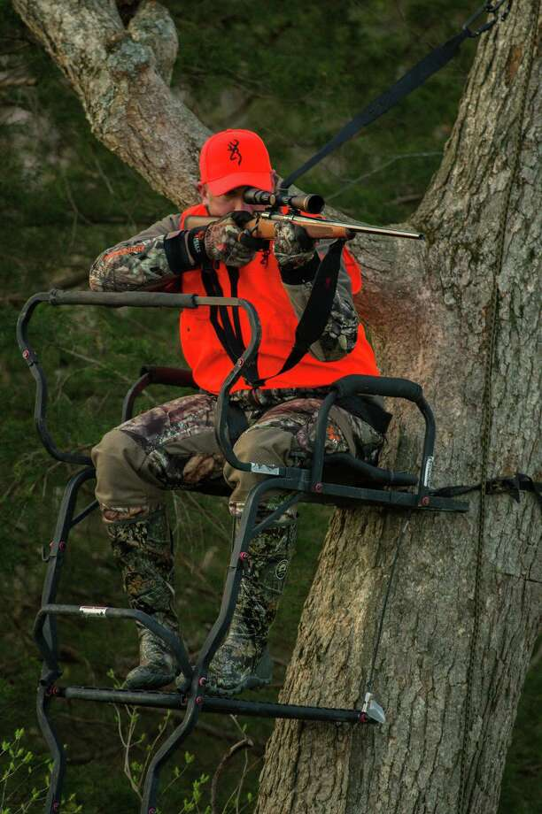 A tree stand like the one pictured has a rail around it as well as a safety harness to prevent the hunter from falling. Photo: Howard Communications / Howard Communications https://www.howardcommunications.com