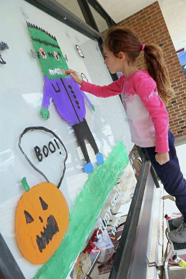Chloe Robbin, 6, of Westport, had to fill the big window of C2 Education for the Chamber of Commerce's annual Halloween window decorating contest on Saturday, Oct. 26, 2019, in Westport, Conn. Photo: Jarret Liotta / Jarret Liotta / ©Jarret Liotta