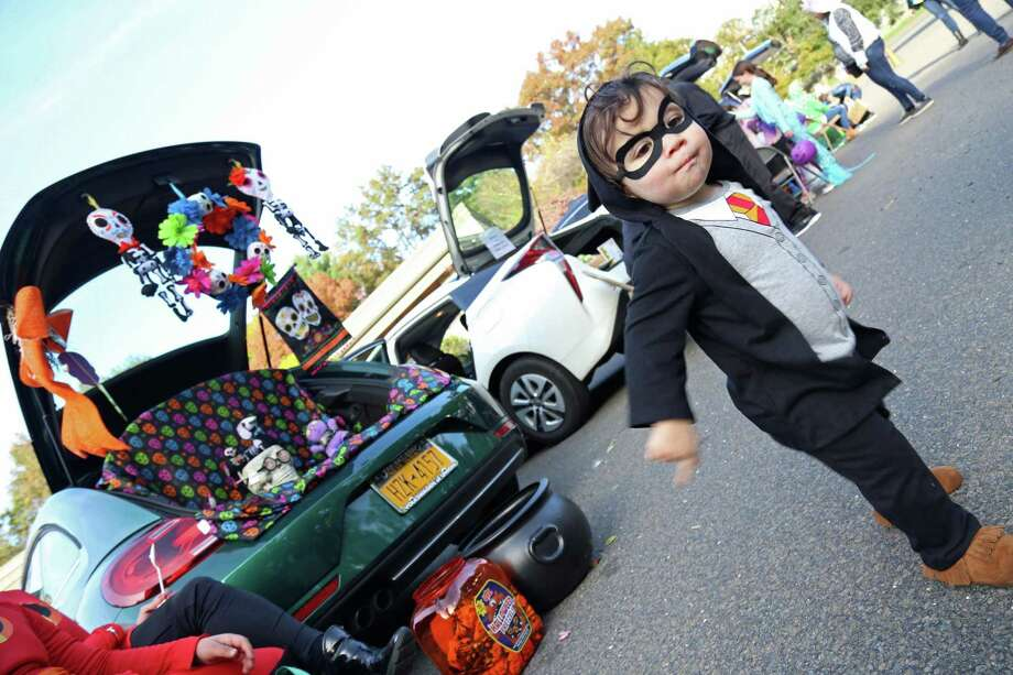 Ari Gerber, 15 months, of Westport, explores the 4th annual Trunk or Treat event at United Methodist Church on Saturday, Oct. 26, 2019, in Westport, Conn. Photo: Jarret Liotta / Jarret Liotta / ©Jarret Liotta