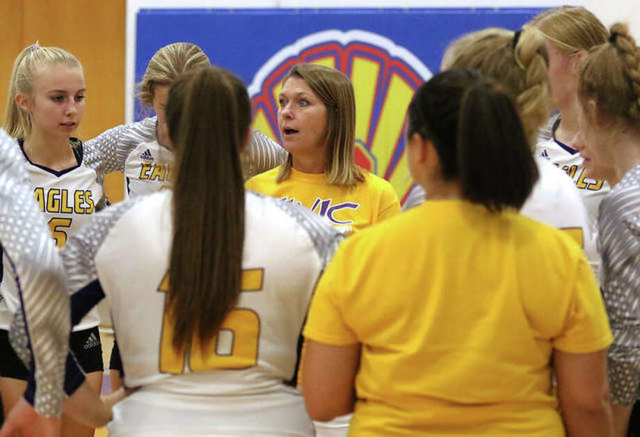 CM coach Kristie Ochs (middle) talks to her team during a timeout in a match earlier this season. The Eagles finished with a 19-16 record after losing to Waterloo on Tuesday night in the semifinals of the CM Class 2A Regional in Bethalto. Photo: Greg Shashack / The Telegraph