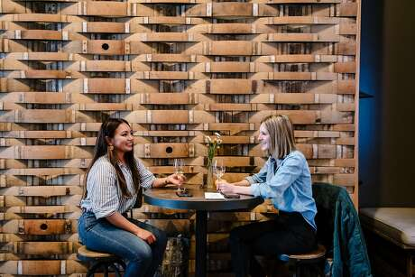 Chariss Camara (left) and Emily McAtee enjoy a tasking session at Bluxome Street Winery, which makes Rosé of Syrah, below. The tasting room will close in December. Photo: Michael Short / Special To The Chronicle