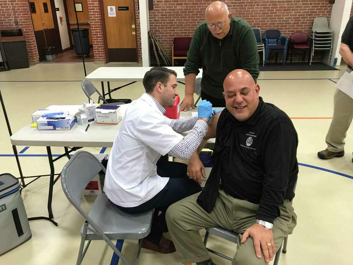 Cromwell Public Health Coordinator Salvatore Nesci gets a flu shot from Stop & Shop Pharmacy Manager Jason Quinn.