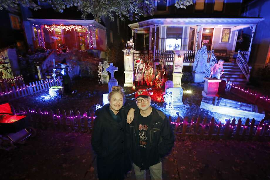 Nelson Gonzalez (right) makes displays that shake, roll, scream and emit smoke outside his Chicago home. Photo: Charles Rex Arbogast / Associated Press