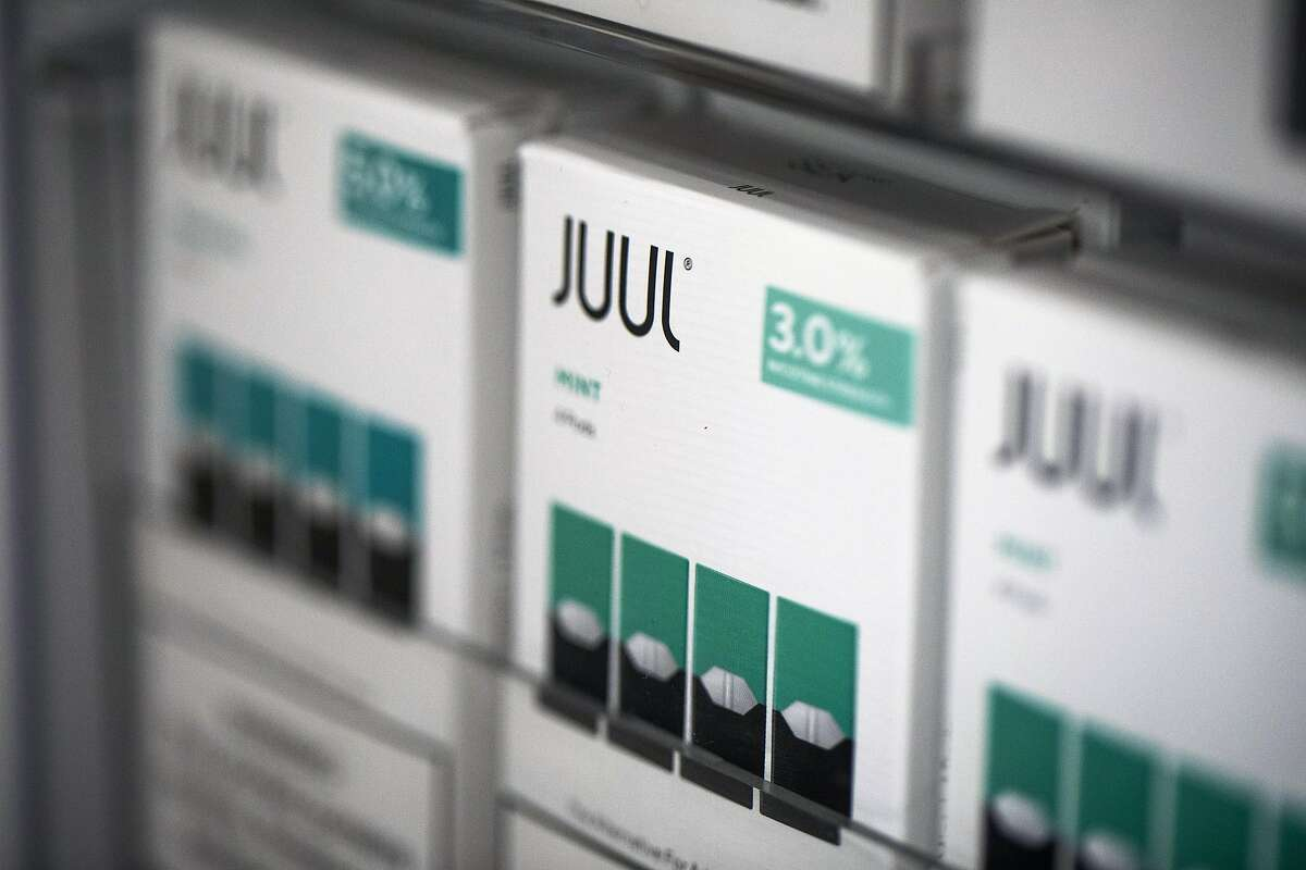 FILE -- Juul products on display at a store in New York on Aug. 1, 2019. A former top executive of Juul is alleging that the e-cigarette giant sold at least one million contaminated mint-flavored nicotine pods -- and refused to recall them when told about the problem in March 2019. (Brittainy Newman/The New York Times)