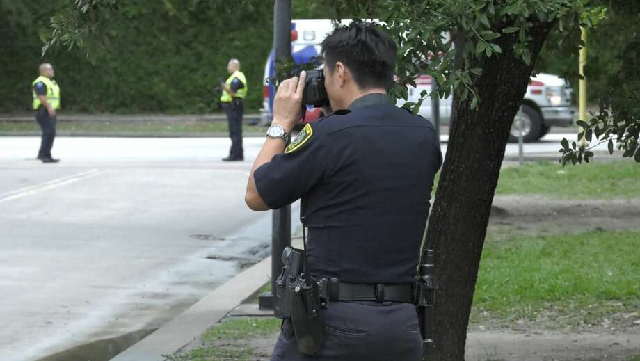 Houston police investigate a deadly auto-pedestrian collision where a woman was run over by her husband, who then took her to a nearby hospital where she was pronounced dead Wednesday, Oct. 30, 2019. Photo: Jay R. Jordan / Houston Chronicle
