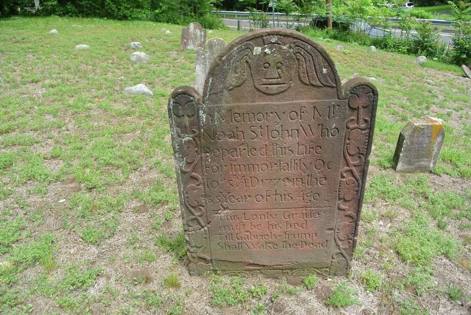 A stone marks the resting place of Noah St. John at the Sharp Hill Cemetery. Photo: Contributed Photo / Wilton Congregational Church / Wilton Bulletin Contributed