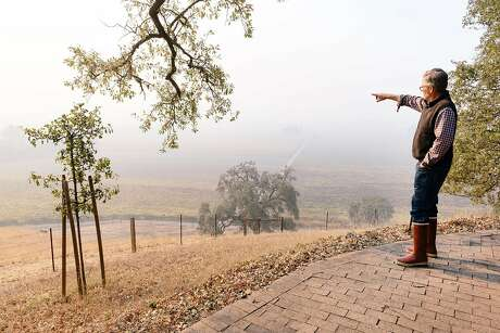 Smoke from the nearby Kincade Fire hang over the vineyard as Parke Hafner, owner and winemaker of Hafner Vineyards, looks out over his property in Healdsburg. Photo: Michael Short / Special To The Chronicle