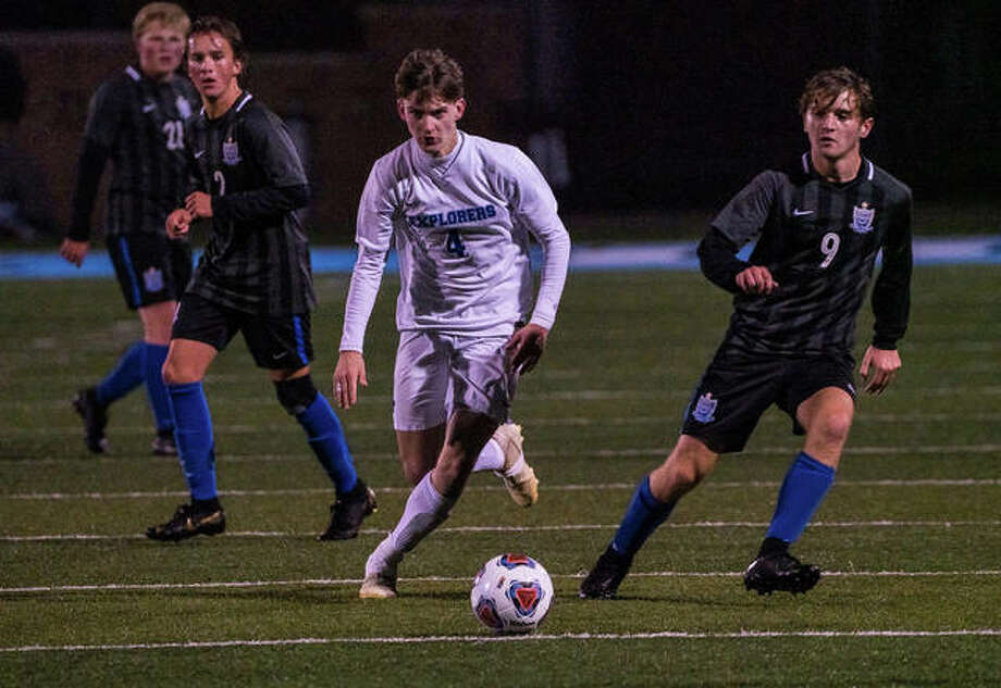Alton Marquette's Drew Whitlock (4) charges Friday night in the Explorer's 2-1 super sectional win over Columbia. Photo: Nathan Woodside | The Telegraph
