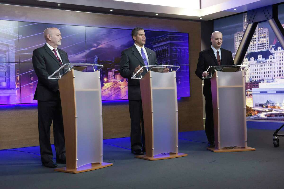 Troy Mayor Patrick Madden, left, former Democratic Troy City Council President Rodney Wiltshire, center, and Tom Reale take part in the Troy Mayoral Debate at Spectrum News Albany on Wednesday, Oct. 30, 2019, in Albany, N.Y. (Paul Buckowski/Times Union)