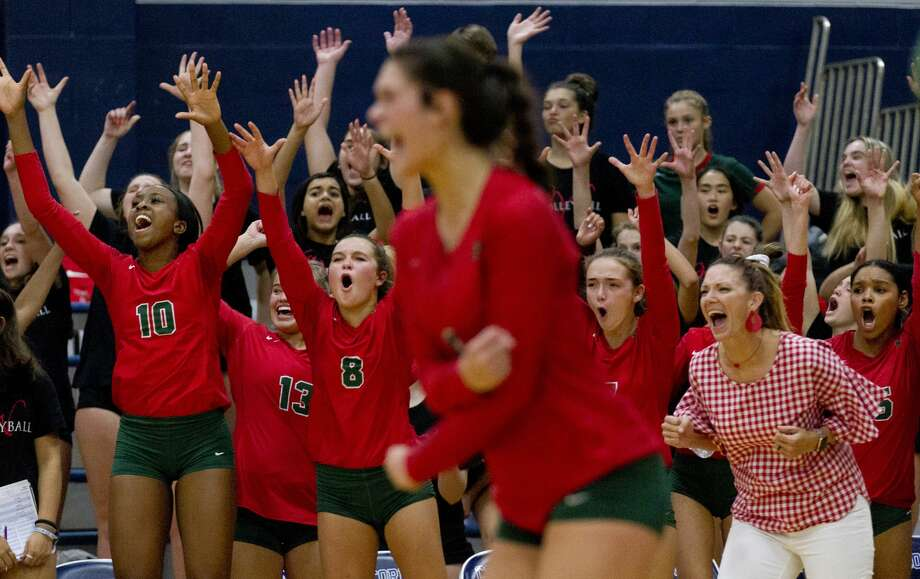 The Woodlands bench reacts after block sealed a 28-26 win over Concordia Lutheran in the first set of a non-district high school volleyball match at Concordia Lutheran High School, Tuesday, Aug. 27, 2019, in Tomball. Photo: Jason Fochtman/Staff Photographer