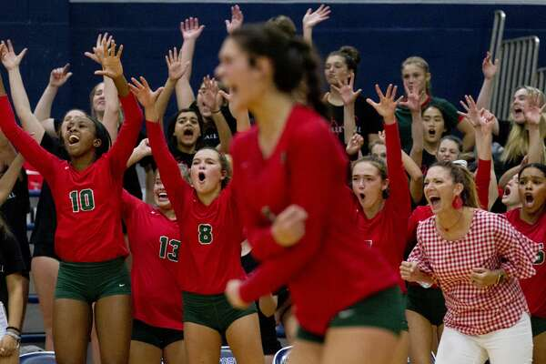 The Woodlands bench reacts after block sealed a 28-26 win over Concordia Lutheran in the first set of a non-district high school volleyball match at Concordia Lutheran High School, Tuesday, Aug. 27, 2019, in Tomball.