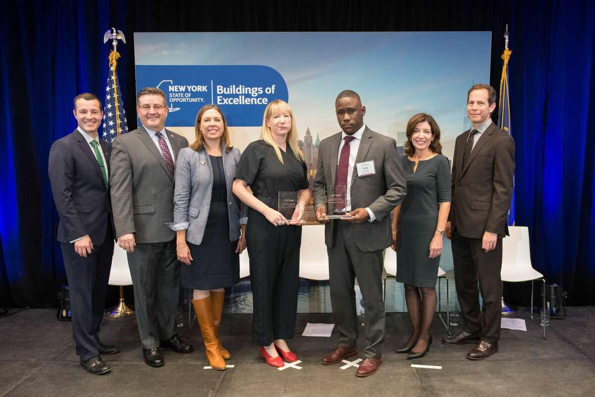 From left, Brendan Hall, of ASHRAE; Mark Kruse, of AIA New York State; Alicia Barton, president and CEO of NYSERDA; design winner Carly Coulson, of Coulson; developer winner Corey Jones, of South End Development; Lt. Gov. Kathy Hochul, Richard Yancy, of the Building Energy Exchange, at the Buildings of Excellence Award Ceremony at the Building Energy Exchange in the Surrogate's Courthouse. (Photo courtesy of Dan Creighton)