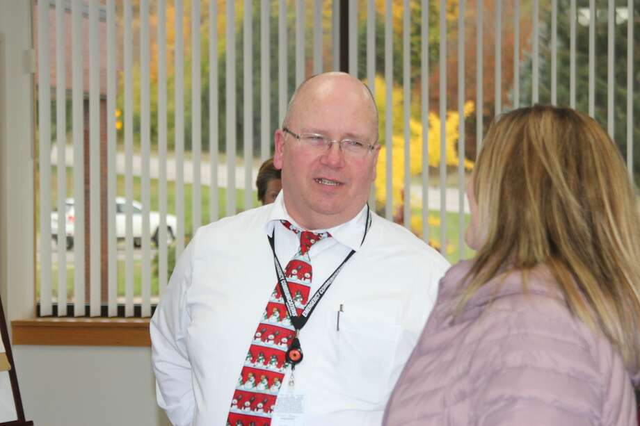 Ron Berns, now retired director of Benzie County Central Dispatch, talks with former dispatcher Nicole Lamerson, who also retired from central dispatch this year after a 25-year-long career. Photo: (Photo/Colin Merry)