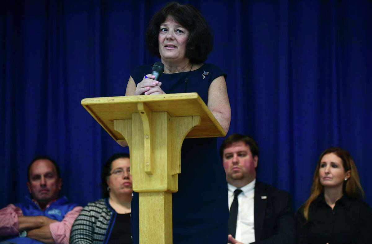 Mayoral candidate Lisa Brinton debates Norwalk Mayor Harry Rilling as candidates for Norwalk's Board of Education debate a number of topics, including racial disparity in the district, Tuesday, October 29, 2019, at Grace Baptist Church in Norwalk, Conn. The debate was hosted by CONECT (Congregations Organized for a New Connecticut).