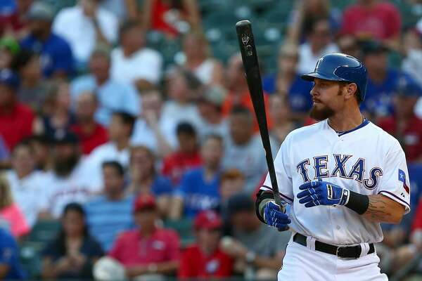 ARLINGTON, TX - AUGUST 03: Josh Hamilton #32 of the Texas Rangers wears Franklin batting gloves as he bats during a game against the Houston Astros at Globe Life Park in Arlington on August 3, 2015 in Arlington, Texas. The Texas Rangers defeated the Houston Astros 12-9. (Photo by Sarah Crabill/Getty Images)
