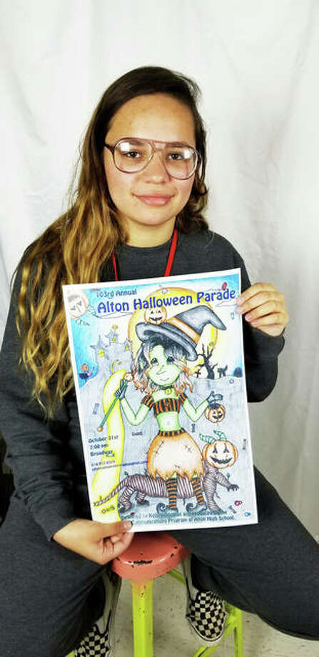 Alton High School junior Kelsea Douglas holds her winning Alton Halloween Parade poster promoting the 103rd Alton Halloween Parade that starts at 7 p.m. on Thursday. Photo: Submitted|For The Telegraph