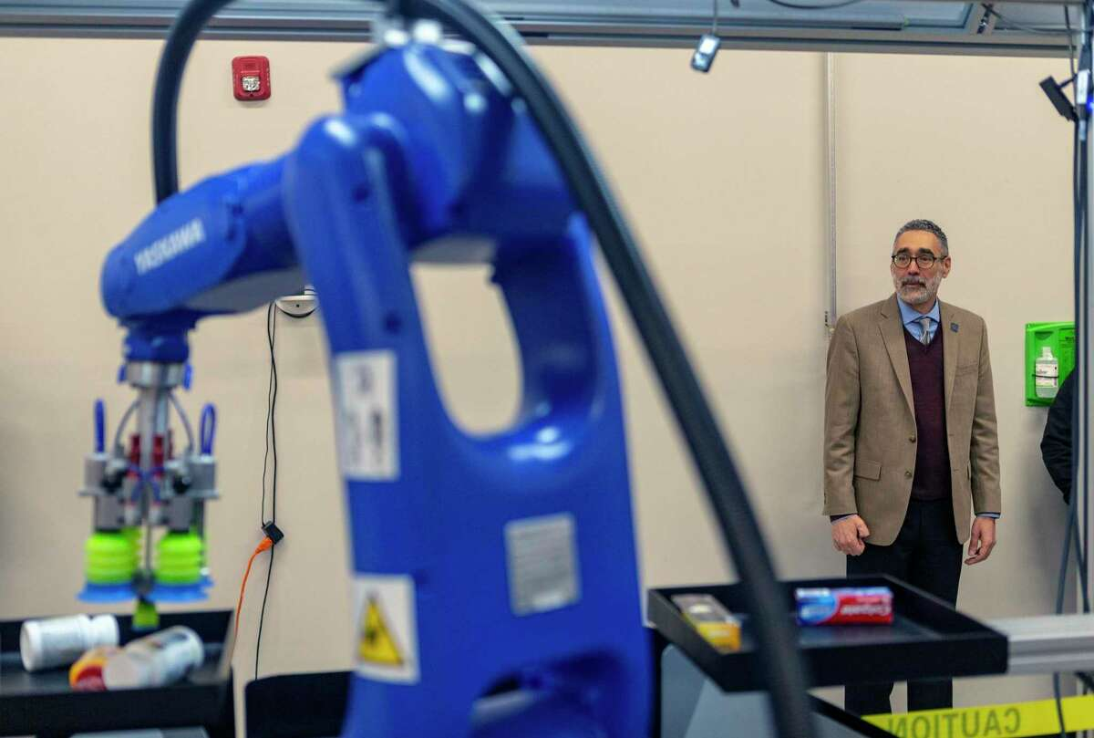 Erik Nieves, Plus One Robotics CEO and co-founder, watches Wednesday, Oct. 30, 2019 a demonstration of the company's products after the ribbon cutting ceremony of the company's new 11,000 square foot facility at Port San Antonio.