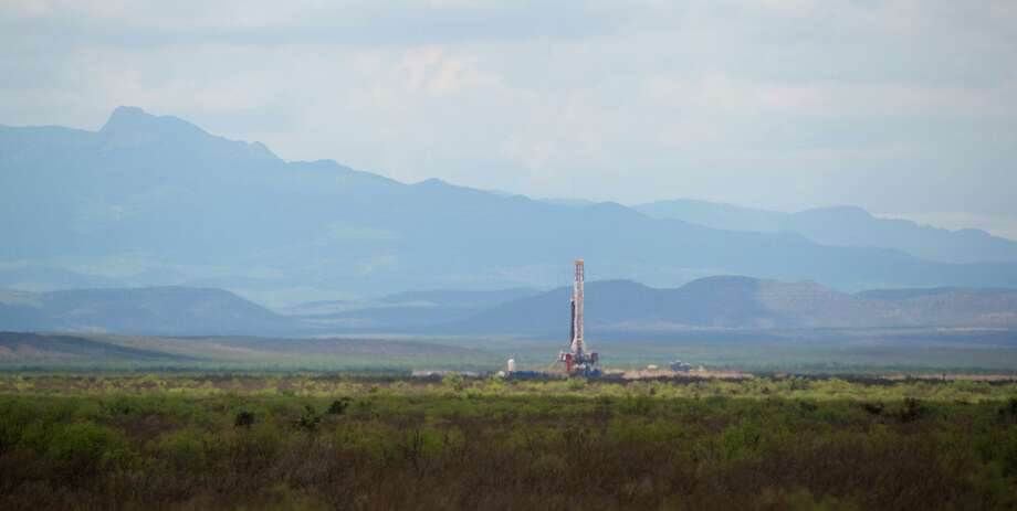 Houston's Apache Corp. drills for oil and gas near the Davis Mountains in West Texas. The Alpine High play in the Permian Basin has produced disappointing results for Apache, partly due to depressed natural gas prices. NEXT: See recent earnings from area energy companies. Photo: Courtesy Gaylon Wampler / Gaylon Wampler    Photography