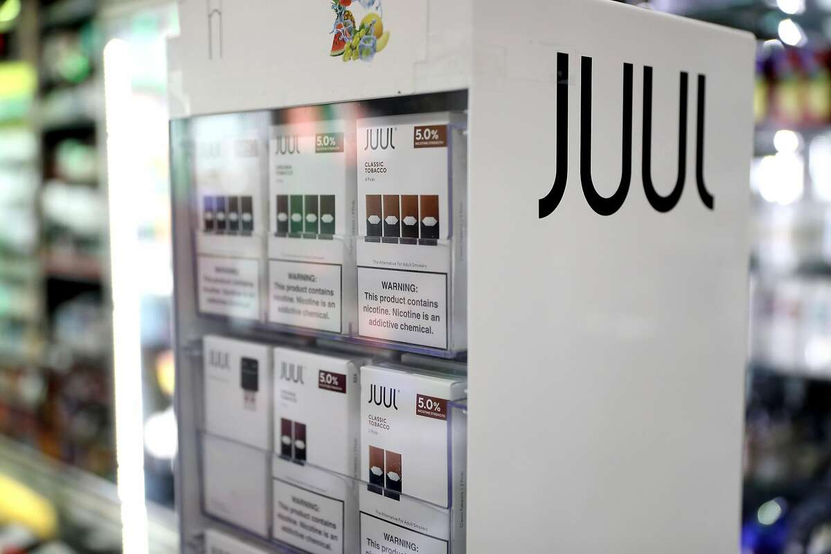 Juul products are displayed at Smoke and Gift Shop on October 17, 2019 in San Francisco, California. Juul announced plans to immediately suspend sales of its fruit flavored e-cigarettes ahead of a policy by the Trump administration that is expected to ban all flavored e-cigarettes. (Photo by Justin Sullivan/Getty Images)