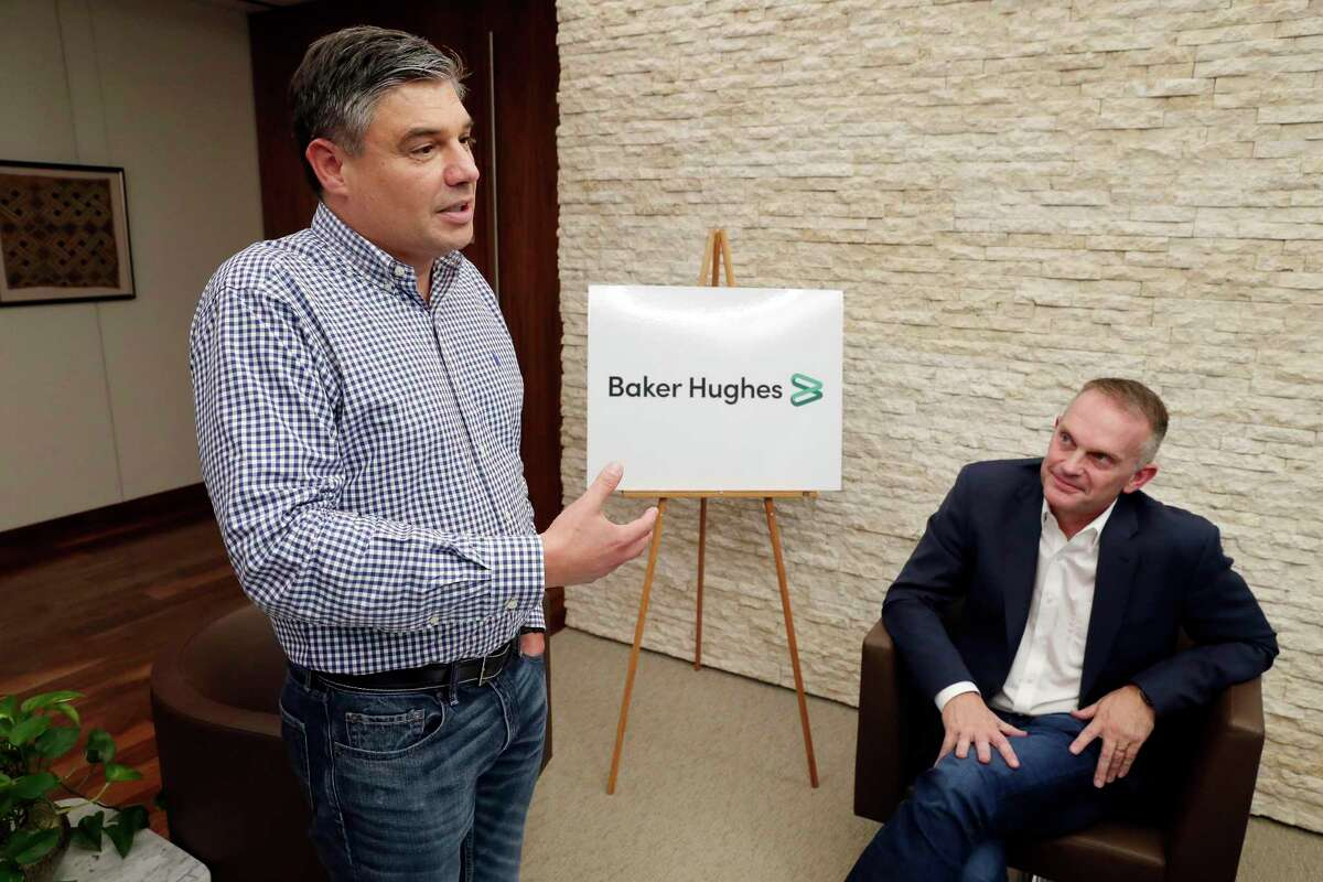 Baker Hughes CEO Lorenzo Simonnelli, left, comments about the new branding logo of Baker Hughes with the downgrading of GE ownership, as Chief Marketing and Technology Officer Derek Mathieson, right, listens. The Houston oil field service company Hhas entered into a three-way agreement and partnership to boost the adoption of artificial intelligence technology in the oil and natural gas industry.