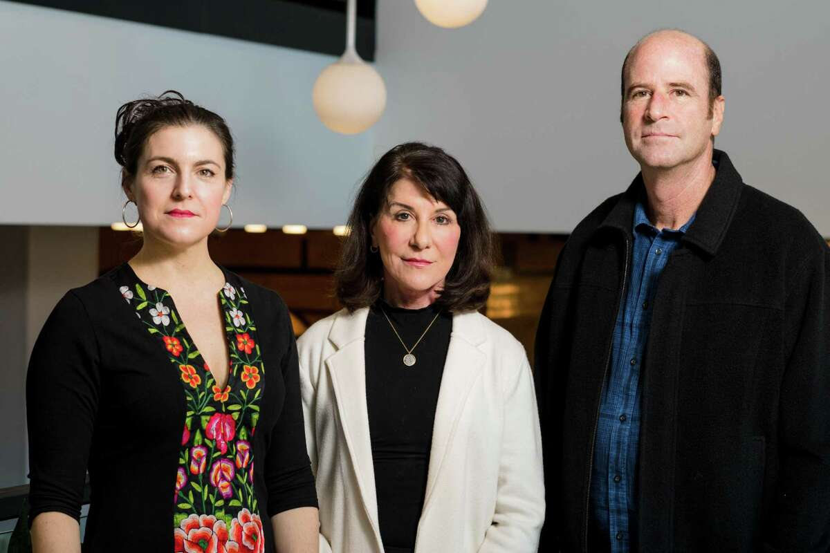 """Katherine Lorenz (left), Sheridan Lorenz (center), and Grant Mitchell, board members of the Cynthia and George Mitchell Foundation, pose for a photo during a meeting in Pittsburgh, PA on Thursday, October 24, 2019. The three are descendants of George Mitchell. Often dubbed the """"father of fracking,"""" George Mitchell revolutionized the oil and gas industry, opening up vast oil and gas deposits long deemed too expensive to drill. Now the Cynthia and George Mitchell Foundation, which he and has wife founded in the 1970s, has evolved into an unlikely critic of the oil and gas boom that has swept Texas and other states. (Joe Appel/Contributor)"""