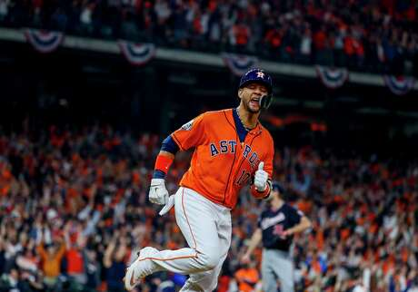 Houston Astros first baseman Yuli Gurriel (10) celebrates as he rounds the bases after hitting a solo home run during the second inning of Game 7 of the World Series at Minute Maid Park on Wednesday, Oct. 30, 2019, in Houston.