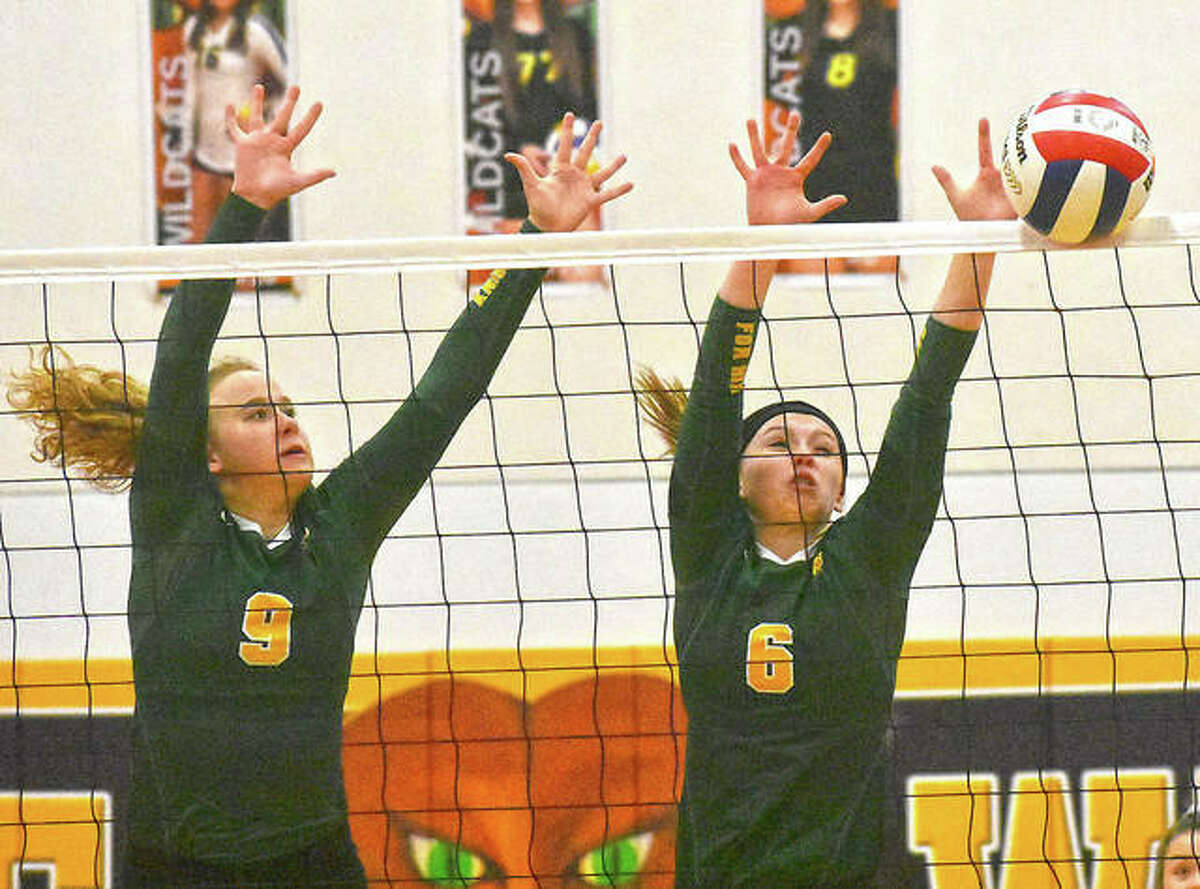Metro's Caitlin Reynolds, left, and Anne Kienle go up for a block in the first game.