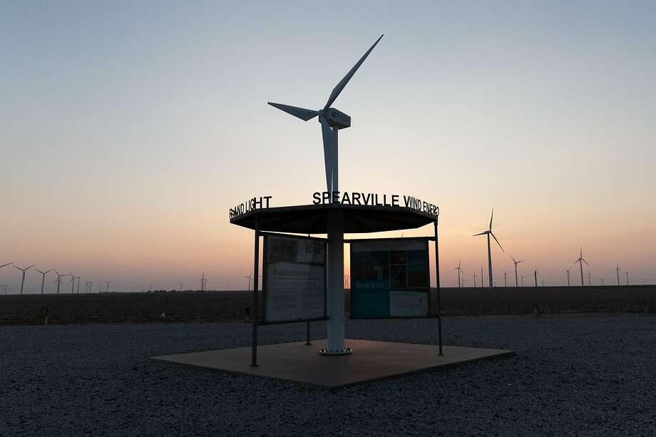 Signage at a wind farm in Spearville, Kan., a town with a population of 793 residents. Photo: Adam Shrimplin / Special To The Chronicle