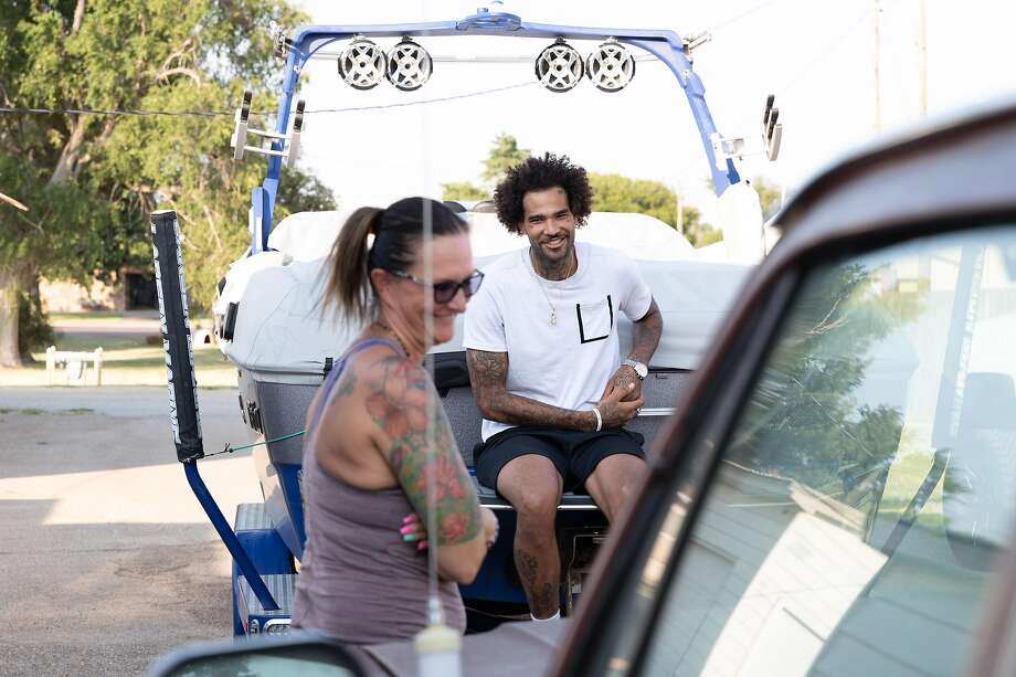 Willie Cauley-Stein shares a laugh with his mother, Marlene, at his childhood home in Spearville, Kan. Photo: Adam Shrimplin / Special To The Chronicle