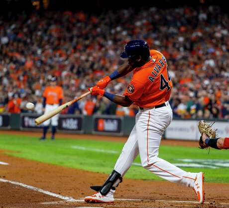 Houston Astros designated hitter Yordan Alvarez (44) hits a single to right field during the second inning of Game 7 of the World Series at Minute Maid Park on Wednesday, Oct. 30, 2019, in Houston.