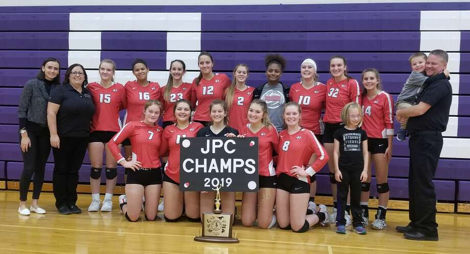 Beaverton's volleyball team poses with its Jack Pine Conference championship trophy Wednesday. Photo: Photo Provided