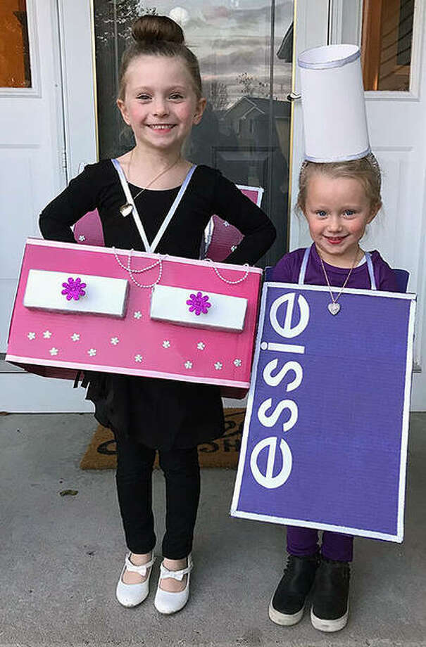 """Adalyn Radosevich (left) titled her costume """"jewelry box ballerina."""" Her sister, Reese Radosevich, chose to be a bottle of """"purple nail paintish."""" Their parents are Megan and Derek Radosevich of Coal Valley and grandparents are Skip and Peggy Bradshaw of Jacksonville. Photo: Photo Provided"""