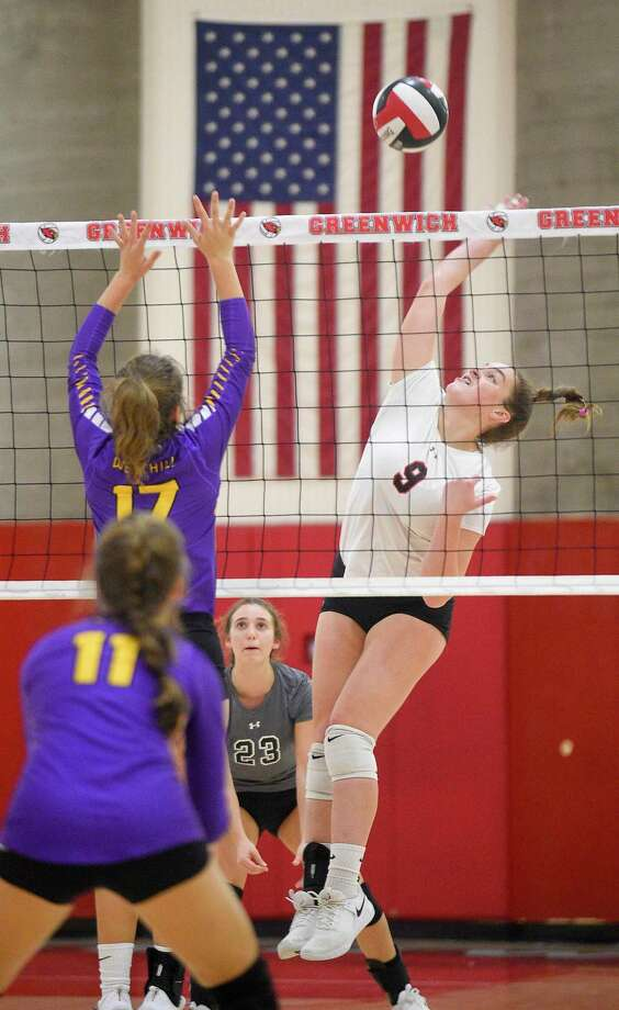 Greenwich's Lily Saleeby (9) hits the ball over against Westhill Sophia Thagouras (17) during a FCIAC girls volleyball league match in Greenwich, Conn., Friday, Oct. 12, 2018. Westhill defeated Greenwich, 3-2, to improve to a 14-1 overall record. Photo: Matthew Brown / Hearst Connecticut Media / Stamford Advocate