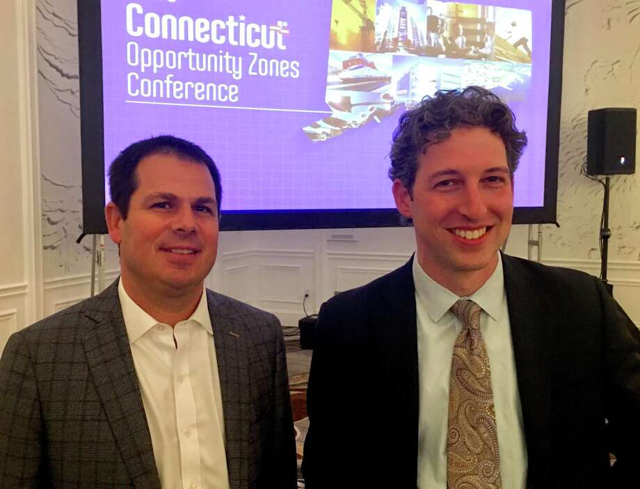 David Lehman, left, and David Kooris, commissioner and deputy commissioner of the state Department of Economic and Community Development, presided over a conference on opportunity zones at the Omni Hotel in New Haven Wednesday, Oct. 30, 2019. The zones offer breaks on capital gains taxes for investors in certain designated areas under the tax reform act of 2017. Photo: Dan Haar /Hearst Connecticut Media /
