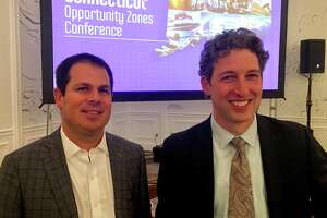 David Lehman, left, and David Kooris, commissioner and deputy commissioner of the state Department of Economic and Community Development, presided over a conference on opportunity zones at the Omni Hotel in New Haven Wednesday, Oct. 30, 2019. The zones offer breaks on capital gains taxes for investors in certain designated areas under the tax reform act of 2017.
