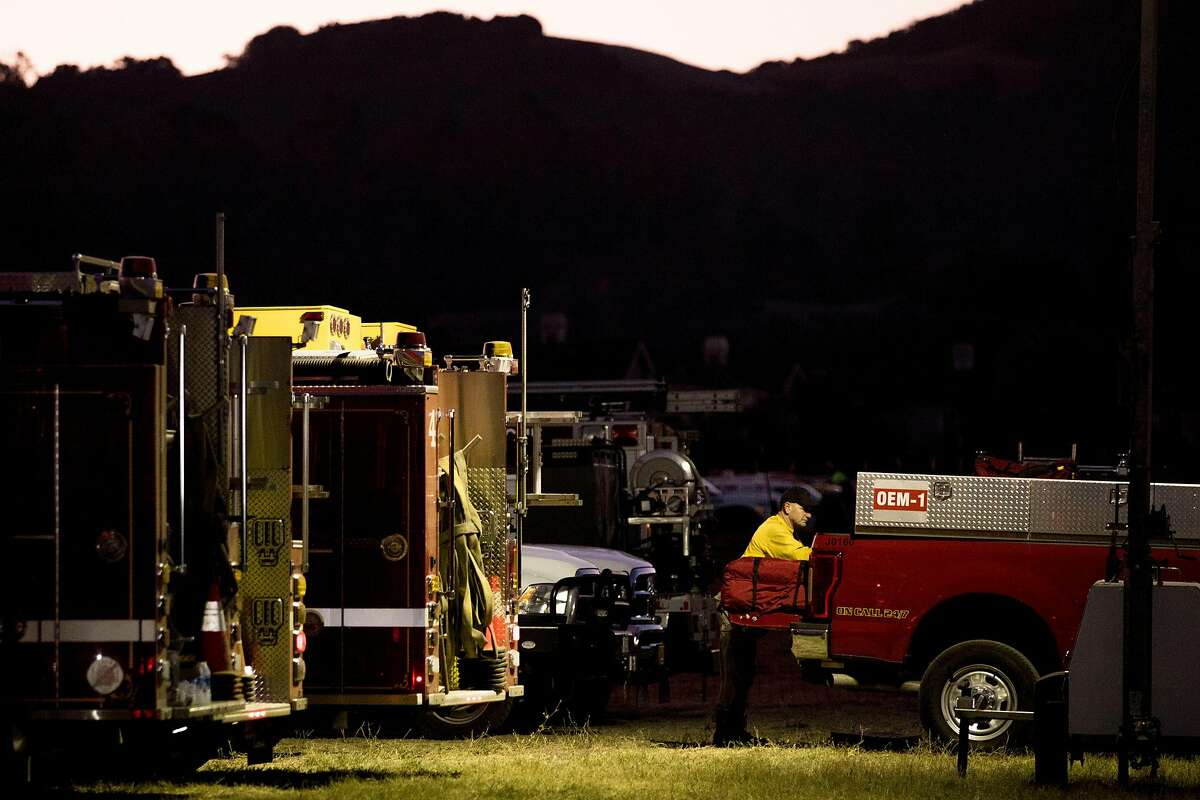 A firefighter loads up his truck before heading out from the Kincade Fire incident base at the Sonoma County Fairgrounds in Santa Rosa, Calif. Wednesday, Oct. 30, 2019.