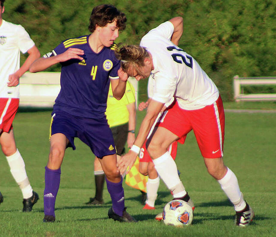 CM's Grant Halley (4) and Triad's Joe Wade go for the ball during a game at the Bethalto Sports Complex earlier this season. Wednesday night, Wade had an assist and Triad defeated CM 4-0 in a semifinal of the Bethalto Class 2A Sectional at Collinsville High School. Photo: Pete Hayes | The Telegraph