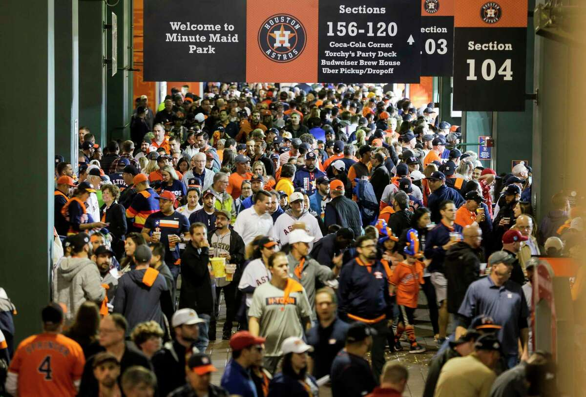 Fans navigate the concourse on the way to their seats before Game 7 of the World Series at Minute Maid Park on Oct. 30, 2019. Two fans who were removed from the ballpark that night are suing the Astros.
